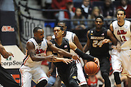 "Missouri's Jordan Clarkson (5) vs. Mississippi's Derrick Millinghaus (3) at the C.M. ""Tad"" Smith Coliseum in Oxford, Miss. on Saturday, February 8, 2014. (AP Photo/Oxford Eagle, Bruce Newman)"