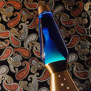 Blue liquid lava lamp from the 1970's with psychedelic, paisley background. Image was originally used for a retro bass ad for Ibanez.