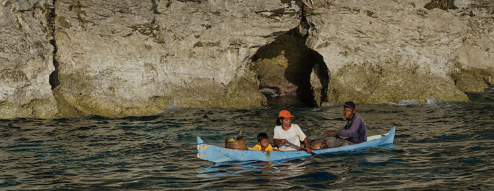 A family of fishers paddles around the back side of Run Island.
