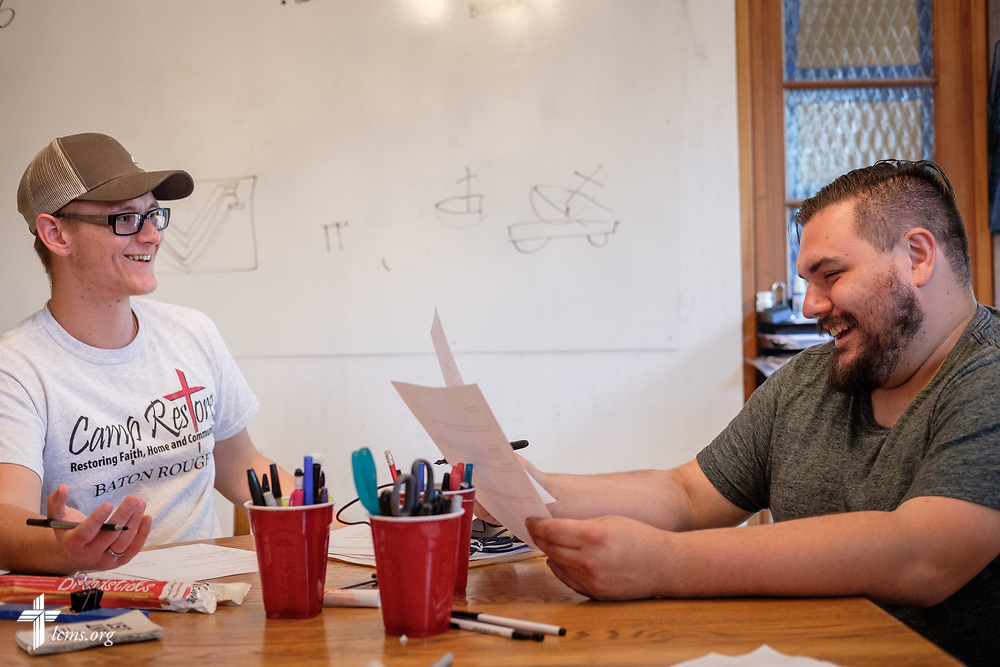Young Adult Corps participant Paul Mroczenski works with Nick Butcher, director of Camp Restore, on Tuesday, April 3, 2018, in Baton Rouge, La. LCMS Communications/Erik M. Lunsford