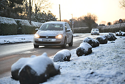 © Licensed to London News Pictures. 30/01/2019. High Wycombe, UK.  Traffic and members of the public struggle through snow and icy conditions in Cryers Hill near High Wycombe, as snow hits the south east of England. Photo credit: Ben Cawthra/LNP