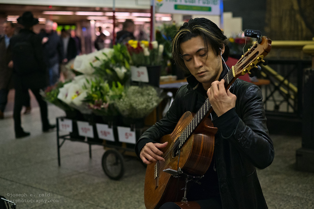 Classical guitarist Shogo Kubo playing in Penn Station, New York, NY, US