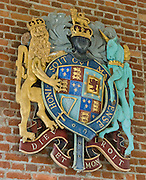 "On the wall of Memorial Church on Jamestown Island, Virginia, is the official Coat of Arms of the United Kingdom and Ireland, used 1603-1649 by James VI (King of Scots), 1660-1689 by Charles II, and 1702-1707 by Queen Anne: The coat features both the motto of the English monarchy, ""Dieu at mon droit"" (""God and my right""), and also the motto of the order of the Garter (Knighthood), ""Honi soit qui mal y pense"" (""Shamed be he who thinks evil of it""). James VI, King of Scots inherited the English and Irish thrones in 1603 (Union of the Crowns), and quartered the Royal Arms of England with those of Scotland. For the first time, the Royal Coat of Arms of Ireland (the harp) was added to represent the Kingdom of Ireland. Jamestown, located on Jamestown Island in the Virginia Colony, was founded on May 14, 1607. It is the first permanent English settlement in what is now the United States of America, following several earlier failed attempts. The Virginia Company of London founded Jamestown in 1607."
