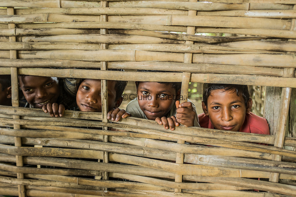Children smile in Bormokuli village, about 45 km from Udalguri. Because of the bad roads it takes about 1 hour 20 mins to reach by vehicle from Udalguri. It is a very poor village in the middle of rice fields
