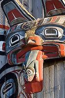 First Nations culture is evident in the  front facade feature on the Port Rupert longhouse near Port Hardy.  Port Rupert, Vancouver Island, British Columbia, Canada.