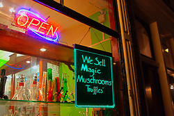 "Sign displaying ""We sell Magic Mushrooms Truffles"" at Store Window, Amsterdam"