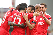 Portugal, FUNCHAL : Benfica's Brazilian forward Jonas celebrates with his teammates after scoring against ... during the Portuguese league football match  CD Nacional vs Benfica at the Madeira stadium in Funchal on November 09, 2014.    AFP PHOTO / GREGORIO CUNHA
