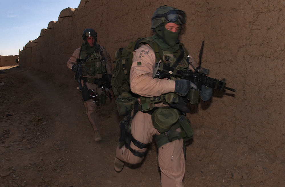 020101-N-2383B-502.HELMAND PROVINCE, Afghanistan (January 01, 2002) --  U.S. Marines with the 26th Marine Expeditionary Unit (Special Operations Capable),  conduct a Cordon and Search Raid at a suspected al Quaeda hideout in the Helmand Province of Afghanistan.  U.S. Marines are in Afghanistan operating in support of Operation Enduring Freedom.  U.S. Navy photo by Chief Photographer's Mate Johnny Bivera, Fleet Combat Camera Atlantic (RELEASED).