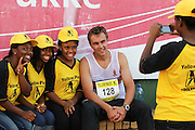 POTCHEFSTROOM, SOUTH AFRICA, Saturday 24 March 2012, LJ van Zyl poses with some of the Yellow Pages girls after the 400m for men during the Yellow Pages Series 2 athletics meeting at the McArthur Stadium..Photo by Roger Sedres/Image SA