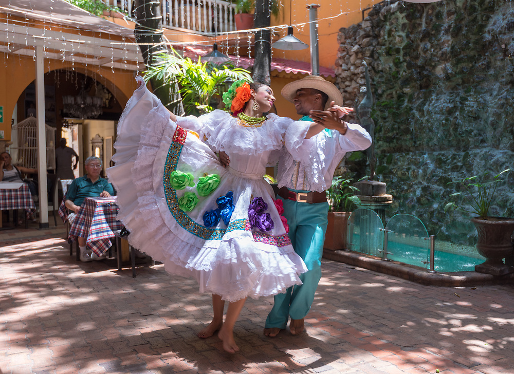 Catagena, Columbia--April 21, 2018. Dancers in traditional garb perform traditional dance in a restaurant.  Editorial use only.