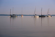 Sailboats sit on a calm Lake Mendota in the early morning at Memorial Union in 2014.