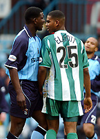 Fotball<br /> Picture: Henry Browne, Digitalsport.<br /> Norway Only<br /> <br /> Date: 10/04/2004.<br /> Coventry City v Millwall Nationwide Division One.<br /> <br /> Ornandi Lowe argues with Marvin Elliott of Millwall.