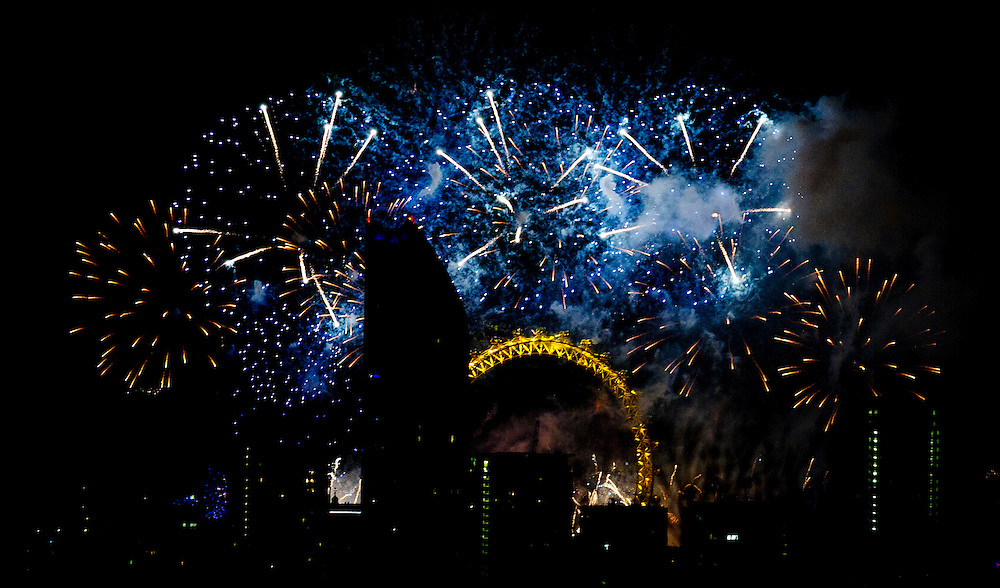 Fireworks over the London Eye seen from the Telegraph Hill Park, mark the coming of the new year in Central London, Britain