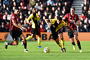 Troy Deeney (9) of Watford battles for possession with Dominic Solanke (9) of AFC Bournemouth and Dan Gosling (4) of AFC Bournemouth during the Premier League match between Bournemouth and Watford at the Vitality Stadium, Bournemouth, England on 12 January 2020.