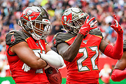 Tampa Bay Buccaneers Linebacker Kevin Minter (51) and Tampa Bay Buccaneers Running Back T. J. Logan (22) celebrate an interception during the International Series match between Tampa Bay Buccaneers and Carolina Panthers at Tottenham Hotspur Stadium, London, United Kingdom on 13 October 2019.
