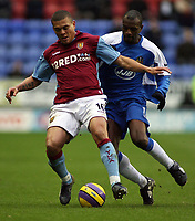 Photo: Paul Thomas.<br /> Wigan Athletic v Aston Villa. The Barclays Premiership. 19/11/2006.<br /> <br /> Emmerson Boyce of Wigan (R) tries to tackle Wilfred Bouma.