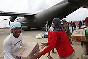Filipino volunteers help unload aid from an RAF C-130 flight in Guiuan, eastern Visayas, Philipines.<br /> <br /> Picture: Russell Watkins/Department for International Development