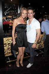 NATALIE BOMGREN and CAMERON MacDONALD at the Beat Summer party hosted by Luca del Bono at L'Atelier De Joel Robuchon, 13-15 West Street, Covent Garden, London on 1st July 2008.<br /><br />NON EXCLUSIVE - WORLD RIGHTS