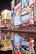 Famous Glico Man and other neon signs above Dotonburi canal.