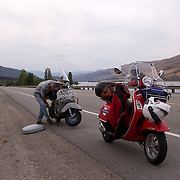 "Robert ""Doc"" Morgan with his Vespa P200E broken down by the side of US Highway 2 near Wenatchee, Washington"