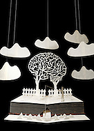 Interlocking Brain Trees With Man Fishing In Stream. Book Sculpture, paper art