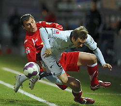 26.02.2010, Volksbank Stadion, Frankfurt, GER, 2. FBL, FSV Frankfurt vs FC Energie Cottbus, im Bild Christian Müller (Mueller) (Frankfurt GER #6) im Zweikampf mit Emil Jula (Cottbus ROM #9) EXPA Pictures © 2010, PhotoCredit: EXPA/ nph/  Roth / for Slovenia SPORTIDA PHOTO AGENCY.