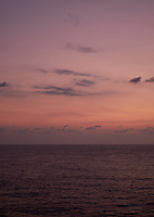 Pastel colored sky and clouds over the Pacific Ocean at dawn.  Image 4 of 21  for a panorama taken with a Fuji X-T1 camera and 35 mm f/1.4 lens  (ISO 400, 35 mm, f/2.8, 1/30 sec). Raw images processed with Capture One Pro and stitched together with AutoPano Giga Pro.