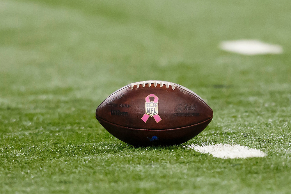 Football with pink ribbon logo for Breast Cancer Awareness is seen during an NFL football game between the Detroit Lions and the Arizona Cardinals at Ford Field in Detroit, Sunday, Oct. 11, 2015. (AP Photo/Rick Osentoski)