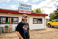 Jeff Ketterling, Fairview Montana, entrepreneur, at his Discount Tobacco & Food Store, also owns RV Park, business is significantly down but recently has slight upturn giving him hope for recovery