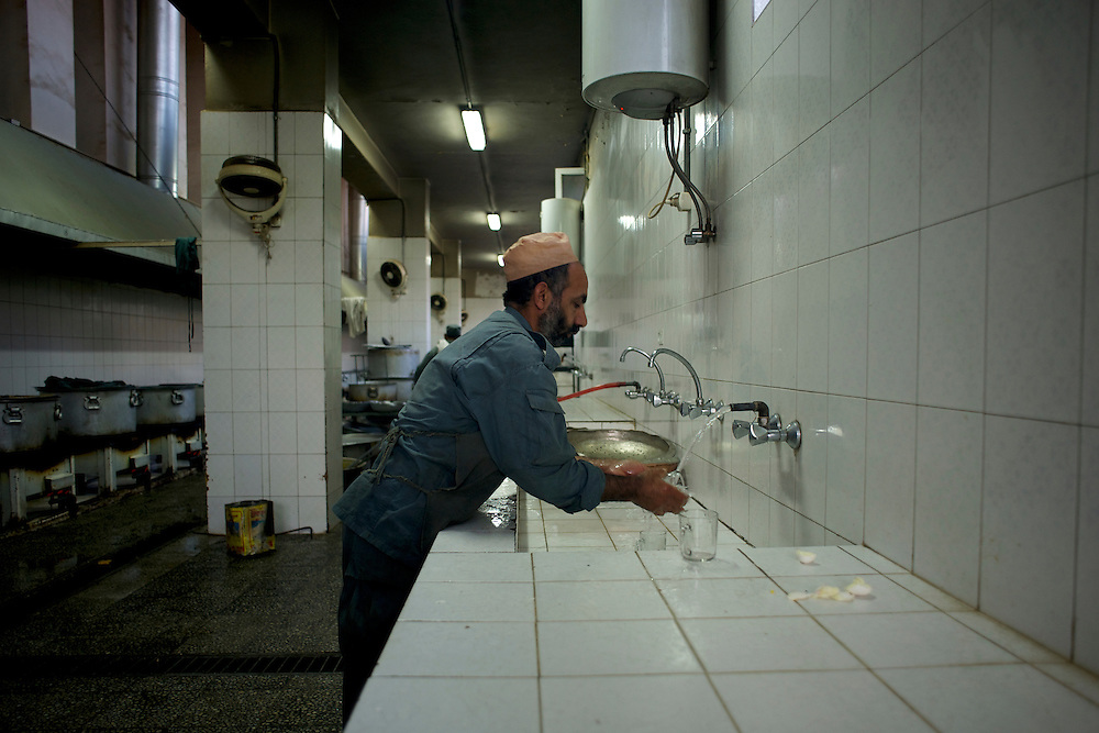 A chef prepares food at the kitchen of the Afghan Nacional Police Academy in Kabul.