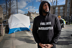 © Licensed to London News Pictures. 07/03/2019. London, UK. Julian Carter, a worker from the violence reduction charity 'Chaos Theory' visits the crime scene in North Birkbeck Road in Leyton in east London where a murder investigation has been launched after a man in his twenties was stabbed on Wednesday. Photo credit: Peter Macdiarmid/LNP