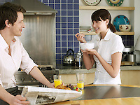Young couple relaxing in kitchen
