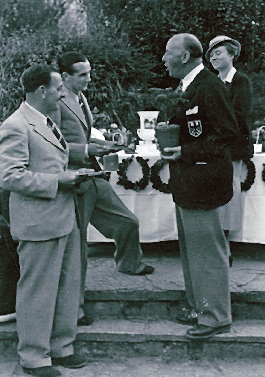 1936 Olympic golf tournament in Baden Baden, Germany._Tom Thirsk_far left_and_Arnold Bentley recieve first prize from DGV President, Karl Henkell.