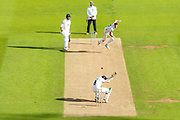 Morne Morkel of Surrey bowls towards Liam Dawson of Hampshire during the Specsavers County Champ Div 1 match between Surrey County Cricket Club and Hampshire County Cricket Club at the Kia Oval, Kennington, United Kingdom on 18 August 2019.