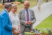 HRH the Countess of Wessex,  patron of the charity, with Nick Caplin, CEO, on Blind Veterans UK: its all about Community Garden by Andrew Fisher Tomlin and Dan Bowyer - The Hampton Court Flower Show, organised by the Royal Horticultural Society (RHS). In the grounds of the Hampton Court Palace, London.