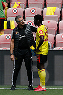 Nigel Pearson manager of Watford talks to Ismaila Sarr of Watford during the Premier League match at Vicarage Road, Watford. Picture date: 20th June 2020. Picture credit should read: Darren Staples/Sportimage