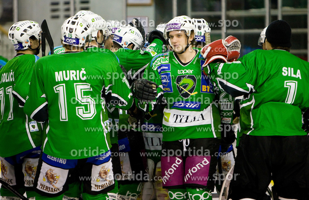 Nejc Berlisk of Tilia Olimpija celebrates after the ice-hockey match in 33rd Round of EBEL league between HDD Tilia Olimpija Ljubljana and EC KAC, Klagenfurt, on December 18, 2009, in Arena Tivoli, Ljubljana, Slovenia. Olimpija defeated KAC 4:2. (Photo by Vid Ponikvar / Sportida)