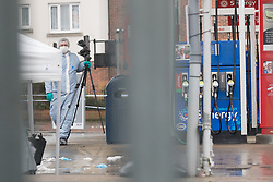 © Licensed to London News Pictures. 09/04/2018. London, UK. Forensic tent and forensic officer on the garage forecort at the scene in Collier Row, Romford where at 4:45hrs a man was shot by police and pronounced dead at the scene. Photo credit: Vickie Flores/LNP