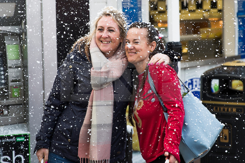 © Licensed to London News Pictures. 17/12/2016. Brighton, UK. Members of the public enjoy the fake snow at the Christmas market on the Brighton Palace Pier. Photo credit: Hugo Michiels/LNP