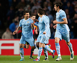 MANCHESTER, ENGLAND - Thursday, March 15, 2012: Manchester City's Sergio Aguero celebrates scoring the third goal against Sporting Clube de Portugal with team-mate Samir Nasri during the UEFA Europa League Round of 16 2nd Leg match at City of Manchester Stadium. (Pic by Vegard Grott/Propaganda)