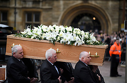 © Licensed to London News Pictures. 31/03/2018. Cambridge, UK. Members of the public watch as the coffin arrives. The funeral of Stephen Hawking at Church of St Mary the Great in Cambridge, Cambridgeshire. Professor Hawking, who was famous for ground-breaking work on singularities and black hole mechanics, suffered from motor neurone disease from the age of 21. He died at his Cambridge home in the morning of 14 March 2018, at the age of 76. Photo credit: Ben Cawthra/LNP