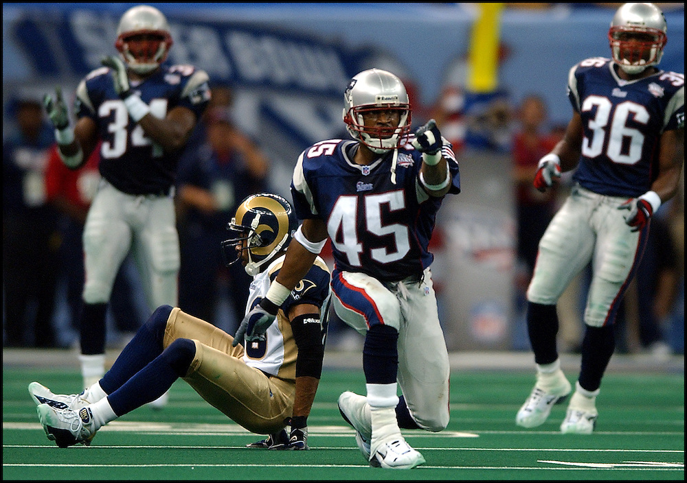 (2/3/02 New Orleans, Lousiana) Super Bowl Patriots vs Rams. Otis Smith signals after breaking up a play with Tory Holt in the 4th. (020302patsmjs-Staff photo byMichael Seamans. Saved in photo mon/FTP.)