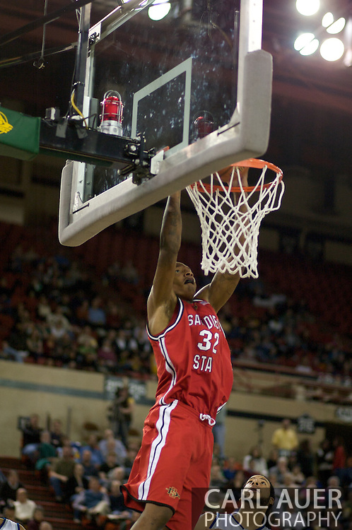 November 29, 2008: San Diego State's Billy White (32) explodes from the baseline for a thunderous dunk in the championship game of the 2008 Great Alaska Shootout at the Sullivan Arena.  San Diego State would keep Hampton scoreless for most of the first 7 minutes of the game and never look back on the Aztec's run to the win Saturday night.