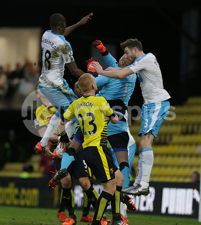 Watford keeper Heurelho Gomes punches clear under pressure from Chancel Mbemba and Paul Dummett during the The FA Cup Third Round match between Watford and Newcastle United at Vicarage Road, Watford, England on 9 January 2016. Photo by Dave Peters.