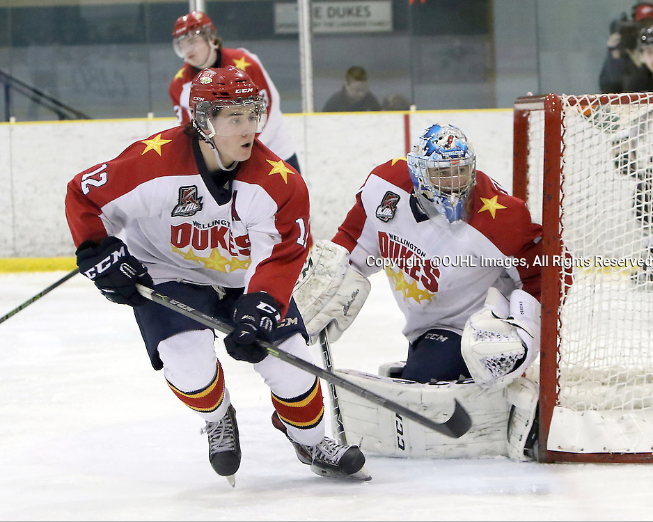 WELLINGTON, - Feb 21, 2016 -  Ontario Junior Hockey League game action between Trenton and Wellington at the Wellington and District Community Centre, ON. Sam Tanguay #1 of the Wellington Dukes and Jacob Panetta #12 of the Wellington Dukes during the second period<br /> (Photo by Ed McPherson / OJHL Images)