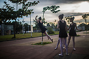 Students show their movements   prior a  ballet class outside a public library in Manguinhos neighbourhood, Rio de Janeiro, Brazil, Monday, June 11, 2018. The Manguinhos community ballet has been a reprieve from the violence and poverty that afflicts its namesake neighborhood for hundreds of girls who have benefitted from free dance classes since 2012. (Dado Galdieri for The New York Times)