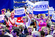 A group of women chant and dance while cheering at the speakers on the final day of the Republican National Conventionat the Tampa Bay Forum in Tampa.