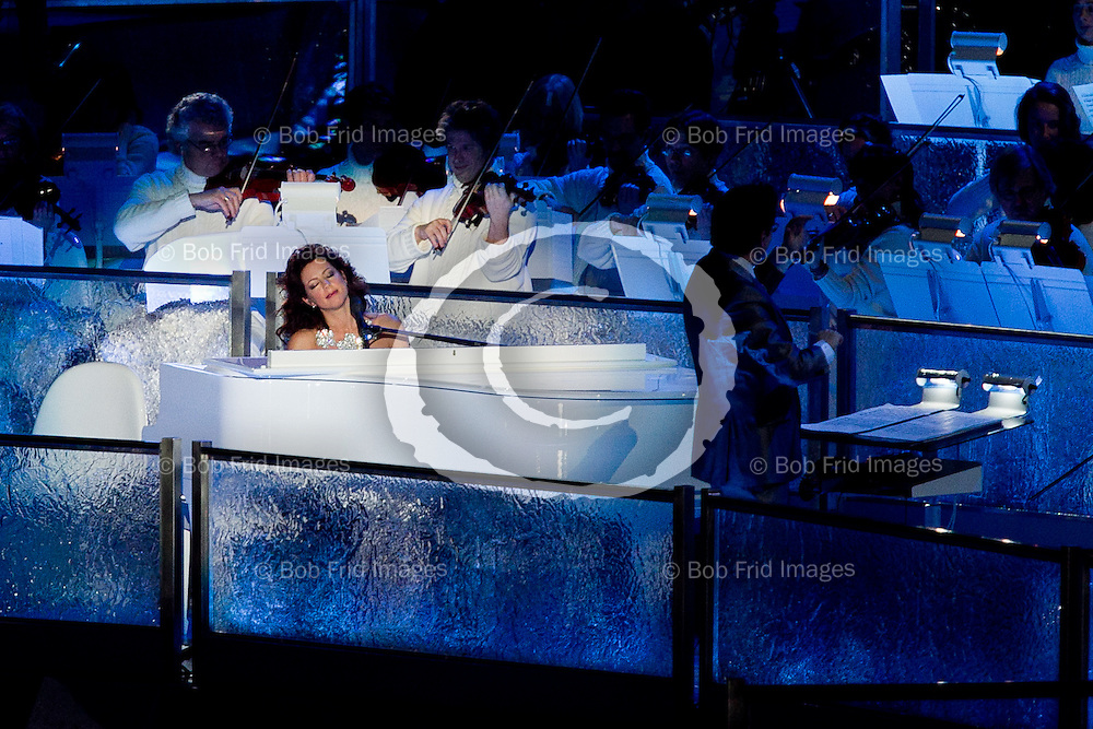 12 February 2010:  Canadian Recoding Artist Sarah McLachlan performs on the piano during The Opening Ceremony of the XXI Olympic Winter Games, the Vancouver 2010 Winter Olympics, held in BC Place Stadium  in Vancouver,  British Columbia, Canada..