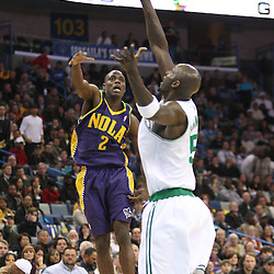 Feb 10, 2010; New Orleans, LA, USA; Boston Celtics forward Kevin Garnett (5) steals a pass away from New Orleans Hornets guard Darren Collison (2) during the third quarter at the New Orleans Arena. The Hornets wearing special Mardi Gras themed uniforms defeated the Celtics 93-85. Mandatory Credit: Derick E. Hingle-US PRESSWIRE