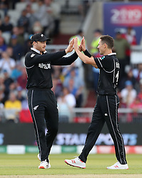 New Zealand's Trent Boult celebrates taking the wicket of West Indies Shai Hope with Martin Guptill during the ICC Cricket World Cup group stage match at Old Trafford, Manchester.